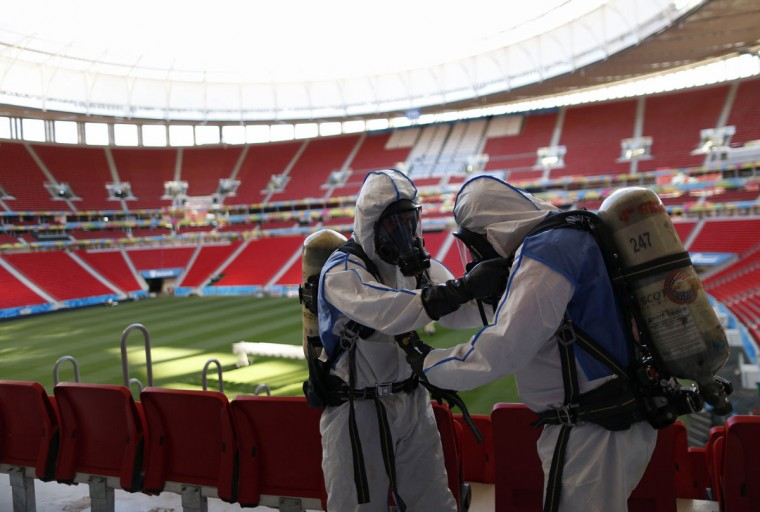 Members of the Brazilian Army take part in a simulated chemical and radiological attack exercise at the Mane Garrincha National Stadium in Brasilia on June 9, 2014. (REUTERS/Ueslei Marcelino)