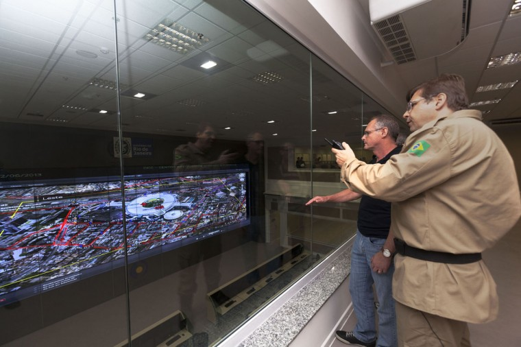 The secretary of security of Rio de Janeiro State, Jose Mariano Beltrame (left), observes with military and police commanders a live image of Maracana soccer stadium as Brazil play against England in a friendly match, at the Integrated Command and Control Center in Rio de Janeiro on June 2, 2013. The state government took journalists on a tour of the center from which all security operations will be monitored during the upcoming Confederations Cup and World Cup. (REUTERS/Ana Carolina Fernades)