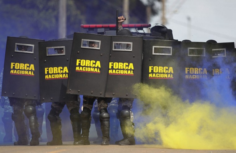 Members of the National Security Force, composed of police and firemen, practice crowd control during training of troops who will provide security at the 2014 World Cup, in Brasilia on February 4, 2014. (REUTERS/Ueslei Marcelino)