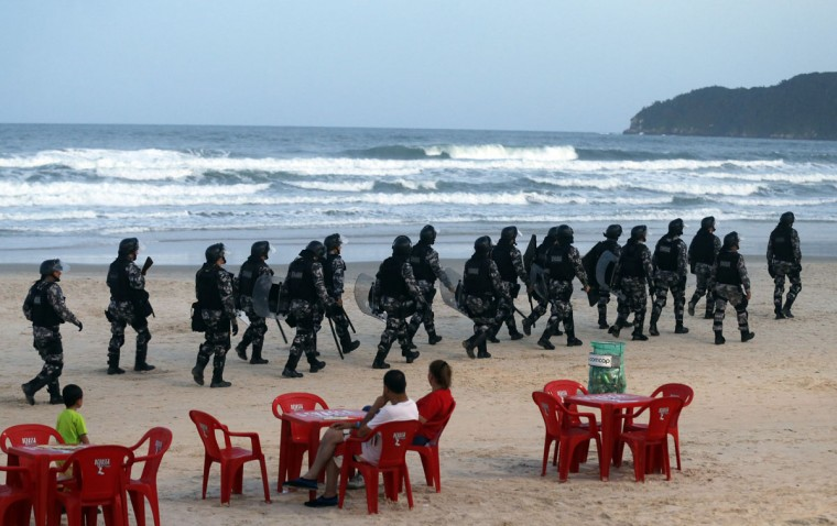 Riot police patrol the Santinho beach next the Costao do Santinho hotel ahead of the 2014 FIFA World Cup in Florianopolis, Santa Catarina state, on February 19, 2014. (REUTERS/Sergio Moraes)