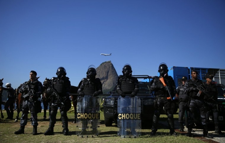 Military police officers stand during a presentation of troops that are responsible for security ahead of the 2014 World Cup, in Rio de Janeiro on May 30, 2014. (REUTERS/Pilar Olivares)