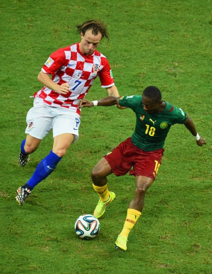 Ivan Rakitic of Croatia and Enoh Eyong of Cameroon compete for the ball during the 2014 FIFA World Cup Brazil Group A match between Cameroon and Croatia at Arena Amazonia on June 18, 2014 in Manaus, Brazil. (Stu Forster/Getty Images)