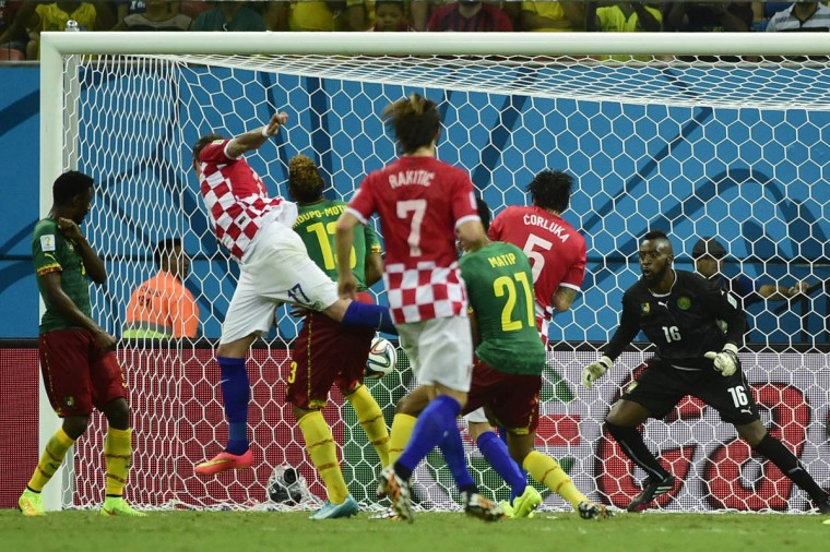 Croatia's forward Mario Mandzukic (2nd Left) heads to score during a Group A football match between Cameroon and Croatia in the Amazonia Arena in Manaus during the 2014 FIFA World Cup on June 18, 2014. (Pierre-Philippe Marcou/Getty Images)