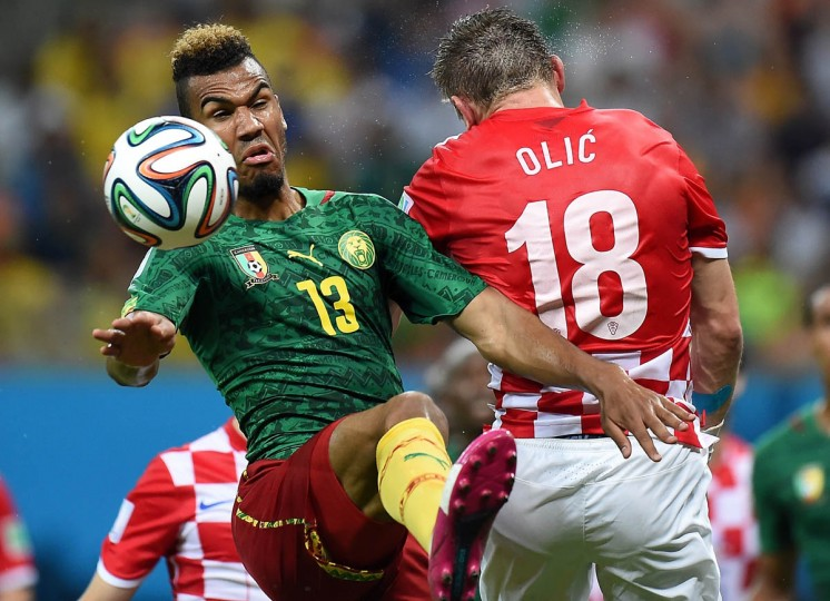 Cameroon's forward Eric Maxim Choupo-Moting (Left) challenges Croatia's forward Ivica Olic for the ball during the Group A football match between Cameroon and Croatia at The Amazonia Arena in Manaus on June 18, 2014, during the 2014 FIFA World Cup. ( Javier Soriano/Getty Images)