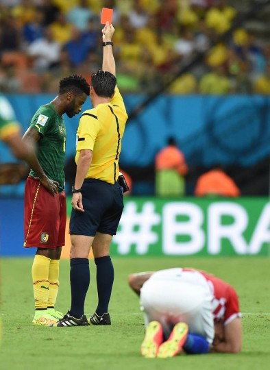 Portuguese referee Pedro Proenca Oliveira Alves Garcia (Center) issues a red card to Cameroon's midfielder Alexandre Song (Left) after a challenge on Croatia's forward Mario Mandzukic (Right) during the Group A football match between Cameroon and Croatia at The Amazonia Arena in Manaus on June 18, 2014, during the 2014 FIFA World Cup. (Javier Soriano/Getty Images)