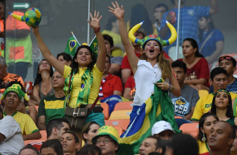 Supporters cheer ahead of the Group A football match between Cameroon and Croatia at The Amazonia Arena in Manaus on June 18, 2014, during the 2014 FIFA World Cup. (Javier Soriano/Getty Images)
