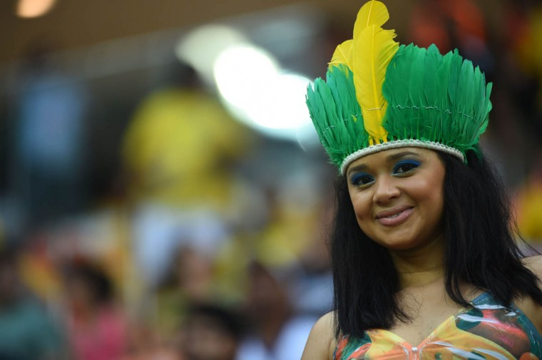 A young supporter poses ahead of the Group A football match between Cameroon and Croatia at The Amazonia Arena in Manaus on June 18, 2014, during the 2014 FIFA World Cup. (Raphael Alves/Getty Images)