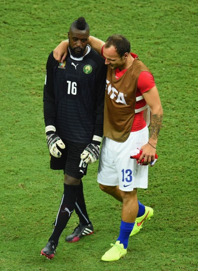 Charles Itandje of Cameroon and Gordon Schildenfeld of Croatia embrace after Croatia defeated Cameroon 4-0 during the 2014 FIFA World Cup Brazil Group A match between Cameroon and Croatia at Arena Amazonia on June 18, 2014 in Manaus, Brazil. (Stu Forster/Getty Images)