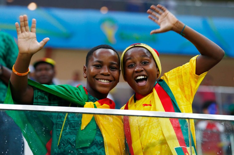Cameroon fans cheer during the 2014 FIFA World Cup Brazil Group A match between Cameroon and Croatia at Arena Amazonia on June 18, 2014 in Manaus, Brazil. (Matthew Lewis/Getty Images)