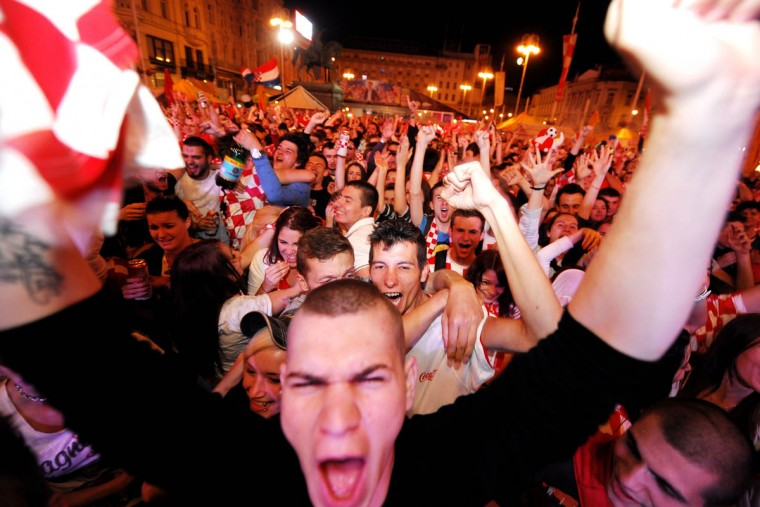 Croatian football fans react as they watch the 2014 FIFA World Cup group A football match between Cameroon and Croatia on June 18, 2014 in the Croatian capital Zagreb's main square. Several thousand people gathered at Zagreb's main square to watch the match between Cameroon and Croatia on a giant screen. (Getty Images)