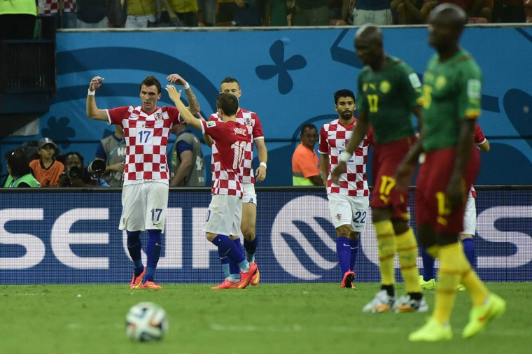 Croatia's forward Mario Mandzukic (Left) celebrates his second goal with teammates during a Group A football match between Cameroon and Croatia in the Amazonia Arena in Manaus during the 2014 FIFA World Cup on June 18, 2014. (Pierre-Philippe Marcou/Getty Images)