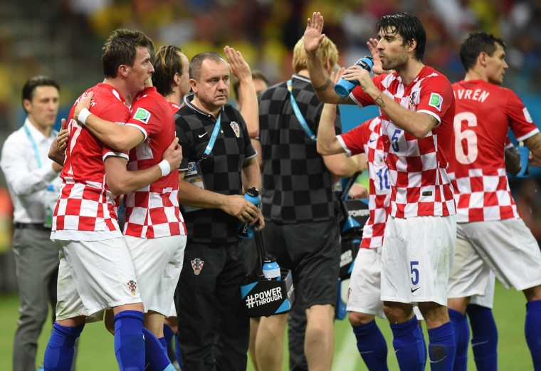 Croatia's forward Mario Mandzukic (Left) celebrates with teammates including Croatia's defender Vedran Corluka (2nd Right) during the Group A football match between Cameroon and Croatia at The Amazonia Arena in Manaus on June 18, 2014, during the 2014 FIFA World Cup. (Javier Soriano/Getty Images)