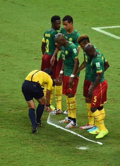 Referee Pedro Proenca sprays a temporary line for a free kick as Cameroon form a wall during the 2014 FIFA World Cup Brazil Group A match between Cameroon and Croatia at Arena Amazonia on June 18, 2014 in Manaus, Brazil. (Stu Forster/Getty Images)