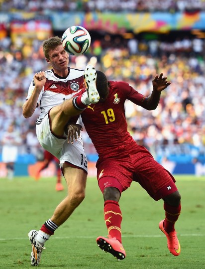 Thomas Mueller of Germany and Jonathan Mensah of Ghana compete for the ball during the 2014 FIFA World Cup Brazil Group G match between Germany and Ghana at Castelao on in Fortaleza, Brazil. (Laurence Griffiths/Getty Images)