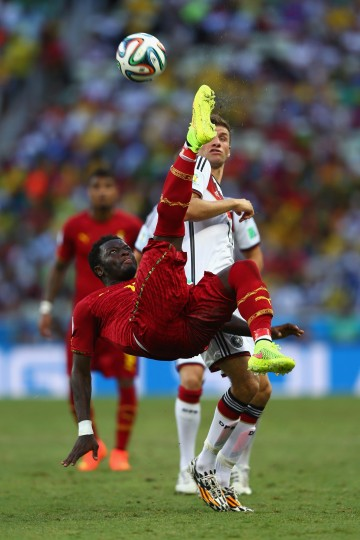 Sulley Muntari of Ghana performs an overhead kick against Thomas Mueller of Germany during the 2014 FIFA World Cup Brazil Group G match between Germany and Ghana at Castelao in Fortaleza, Brazil. (Michael Steele/Getty Images)
