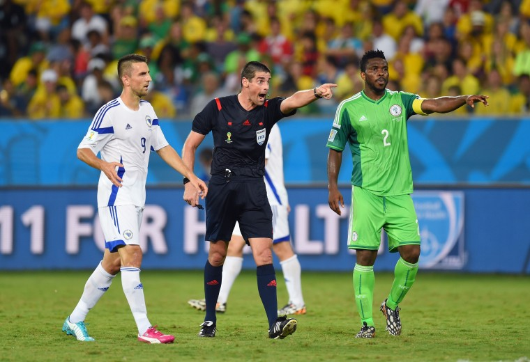 Referee Peter O Leary gestures with Joseph Yobo of Nigeria and Vedad Ibisevic of Bosnia and Herzegovina during the 2014 FIFA World Cup Group F match between Nigeria and Bosnia-Herzegovina at Arena Pantanal in Cuiaba, Brazil. (Stu Forster/Getty Images)