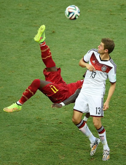Ghana's midfielder Sulley Ali Muntari (L) kicks the ball past Germany's forward Thomas Mueller during a Group G football match between Germany and Ghana at the Castelao Stadium in Fortaleza during the 2014 FIFA World Cup. The game ended with a draw 2-2. (Emmanuel Dunand/AFP-Getty Images)