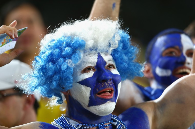 A Honduras fan cheers prior to the 2014 FIFA World Cup Brazil Group E match between Honduras and Ecuador at Arena da Baixada in Curitiba, Brazil. (Julian Finney/Getty Images)