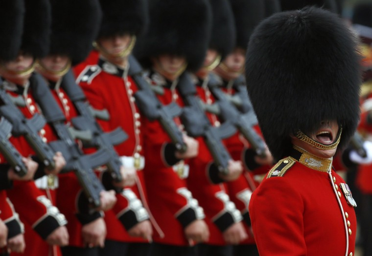 Guardsmen of the Scots Guards parade during the Trooping the Colour ceremony at Horse Guards Parade in London. Trooping the Colour is a ceremony to honor the Queen Elizabeth's official birthday. (Luke MacGregor/Reuters)