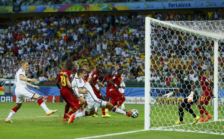 Germany's Miroslav Klose (C) taps the ball in to score against Ghana during their 2014 World Cup Group G soccer match at the Castelao arena in Fortaleza. (Eddie Keogh/Reuters)