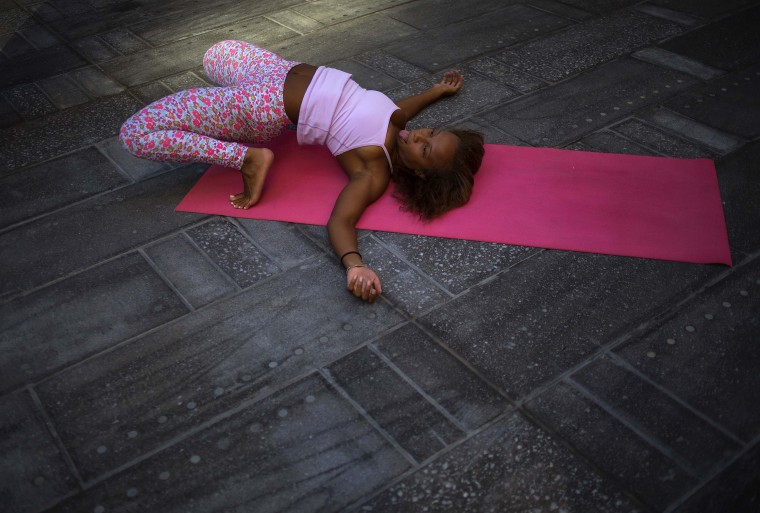 A woman practices yoga in Times Square as part of a Summer Solstice celebration in New York. (Eric Thayer/Reuters)