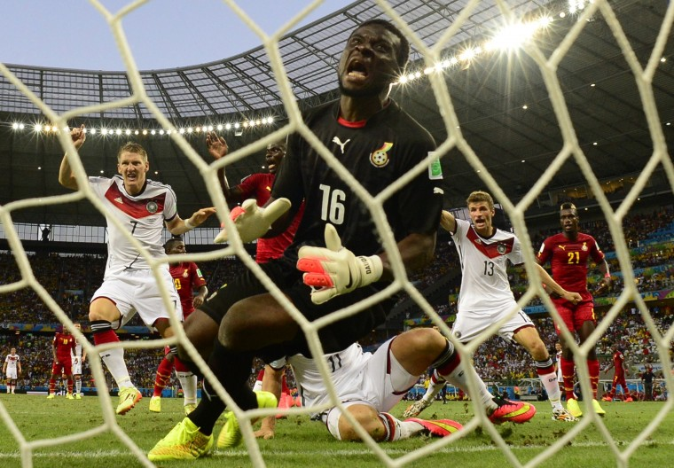 Ghana's goalkeeper Fatau Dauda fails to save a goal during a Group G football match between Germany and Ghana at the Castelao Stadium in Fortaleza during the 2014 FIFA World Cup. (Javier Soriano/AFP-Getty Images)