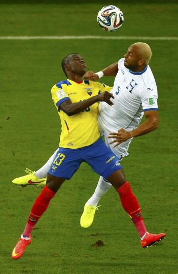 Ecuador's Enner Valencia (13) collides with Victor Bernardez (5) of Honduras as they fight for the ball during their 2014 World Cup Group E soccer match at the Baixada arena in Curitiba. (Amr Abdallah Dalsh/Reuters)