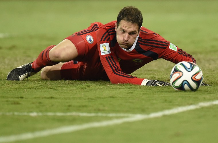 Bosnia-Hercegovina's goalkeeper Asmir Begovic eyes the ball during the Group F football match between Nigeria and Bosnia-Hercegovina at the Pantanal Arena in Cuiaba during the 2014 FIFA World Cup. (Juan Barreto/AFP-Getty Images)