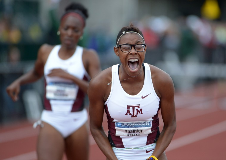 Shamier Little of Texas A&M celebrates after winning the womens 400m hurdles in 55.07 in the 2014 NCAA Track & Field Championships at Hayward Field in Eugen, Or. (Kirby Lee/USA Today Sports)