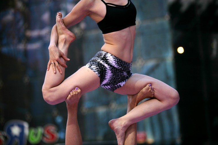Over 8,000 people practice yoga as a salute to the sun at the 12th Annual Solstice in Times Square in New York City. The day-long, free yoga event was sponsored by Athleta and the Times Square Alliance. (Photo by Yana Paskova/Getty Images)