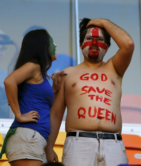 Fans wait for the 2014 World Cup Group D soccer match between England and Italy at the Amazonia arena in Manaus. (Ivan Alvarado/Reuters)