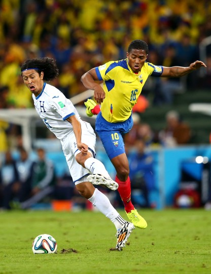 Roger Espinoza of Honduras competes for the ball with Antonio Valencia of Ecuador during the 2014 FIFA World Cup Brazil Group E match between Honduras and Ecuador at Arena da Baixada in Curitiba, Brazil. (Julian Finney/Getty Images)
