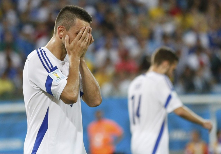 Bosnia's Vedad Ibisevic reacts to a missed goal opportunity against Nigeria during their 2014 World Cup Group F soccer match at the Pantanal arena in Cuiaba. (Ueslei Marcelino/Reuters)