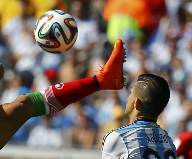 Iran's Mehrdad Pouladi (L) fights for the ball with Argentina's Sergio Aguero during their 2014 World Cup Group F soccer match at the Mineirao stadium in Belo Horizonte. (Kai PfaffenbachReuters)