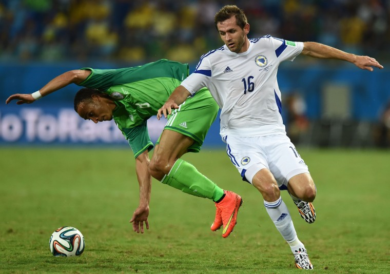 Bosnia-Hercegovina's midfielder Senad Lulic (R) challenges Nigeria's forward Peter Odemwingie during the Group F football match between Nigeria and Bosnia-Hercegovina at the Pantanal Arena in Cuiaba during the 2014 FIFA World Cup. (Jewel Samad/AFP-Getty Images)
