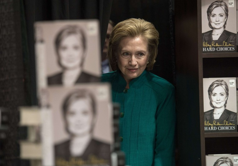 "Former U.S. Secretary of State Hillary Clinton arrives to sign her new book ""Hard Choices"" in Arlington, Va. Clinton is widely thought to be mulling a run for the 2016 presidential election (Nicholas Kamm/AFP-Getty Images)"