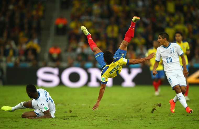 Jefferson Montero of Ecuador falls after a challenge by Maynor Figueroa of Honduras during the 2014 FIFA World Cup Brazil Group E match between Honduras and Ecuador at Arena da Baixada in Curitiba, Brazil. (Clive Rose/Getty Images)