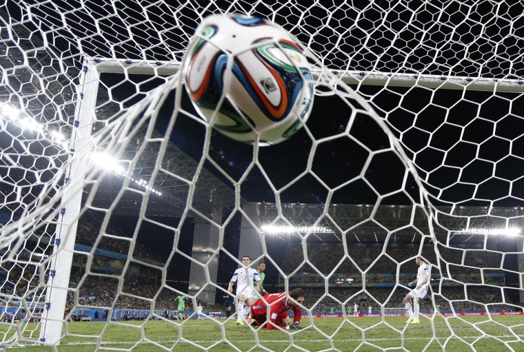 Nigeria's Peter Odemwingie scores a goal during their 2014 World Cup Group F soccer match against Bosnia at the Pantanal arena in Cuiaba. (Michael Dalder/Reuters)