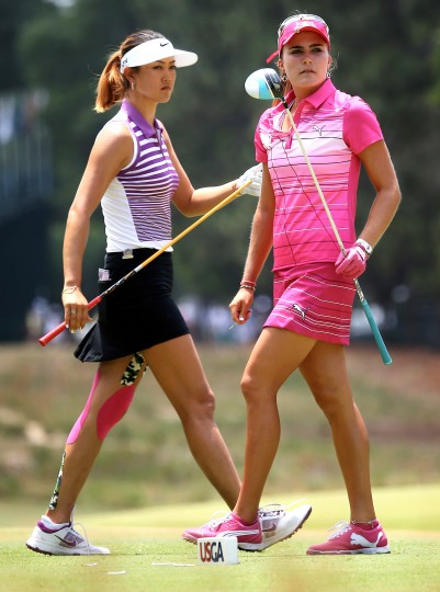 Lexi Thompson walks past Michelle Wie on the second tee during the third round of the 69th U.S. Women's Open at Pinehurst Resort & Country Club, Course No. 2 in Pinehurst, N.C. (Streeter Lecka/Getty Images)