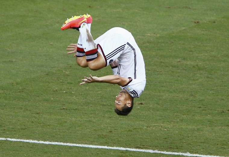 Germany's Miroslav Klose executes a somersault as he celebrates scoring a goal against Ghana during their 2014 World Cup Group G soccer match at the Castelao arena in Fortaleza. (Mike Blake/Reuters)