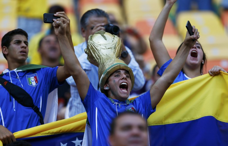 Fans of Italy wait for the start of their 2014 World Cup Group D soccer match against England at the Amazonia arena in Manaus. (Ivan Alvarado/Reuters)