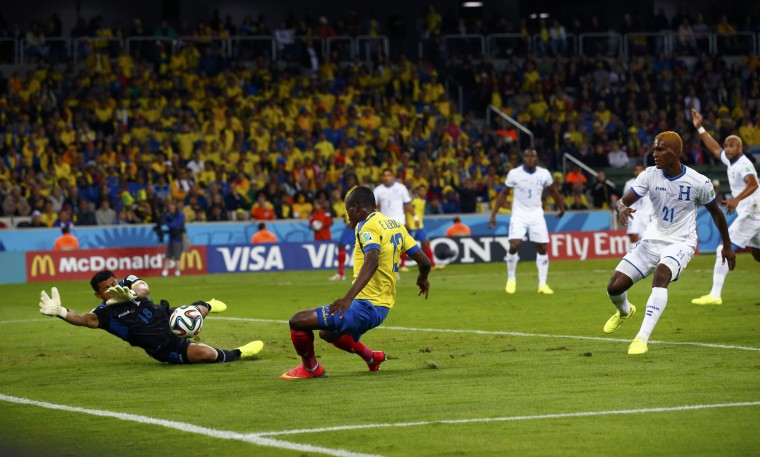 Ecuador's Enner Valencia scores past goalkeeper Noel Valladares of Honduras during their 2014 World Cup Group E soccer match at the Baixada arena in Curitiba, Brazil. (Darren Staples/Reuters)