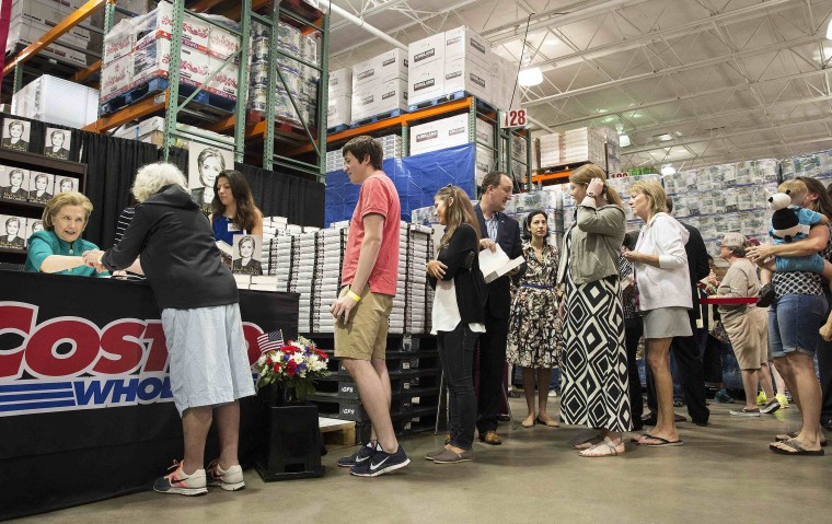 "Former U.S. Secretary of State Hillary Clinton signs copies of her new book ""Hard Choices"" at a Costco in Arlington, Va. (Joshua Roberts/Reuters)"