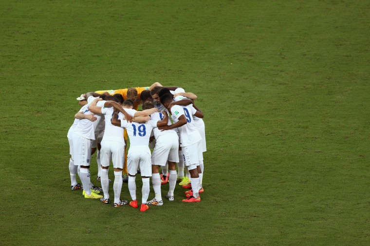 England teammates embrace before the 2014 FIFA World Cup Brazil Group D match between England and Italy at Arena Amazonia in Manaus, Brazil. (Warren Little/Getty Images)