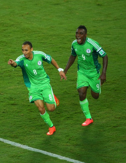 Peter Odemwingie of Nigeria (L) celebrates scoring his team's first goal with teammate Emmanuel Emenike during the 2014 FIFA World Cup Group F match between Nigeria and Bosnia-Herzegovina at Arena Pantanal in Cuiaba, Brazil. (Clive Brunskill/Getty Images)