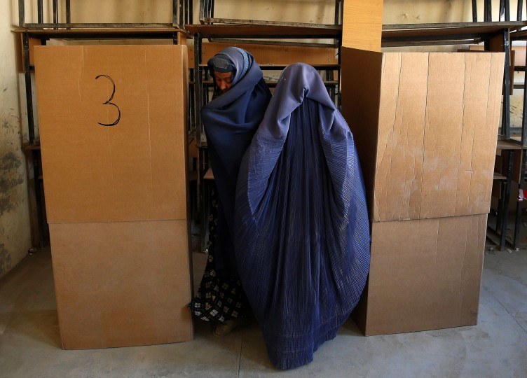 Afghan women prepare to cast their votes at a polling station in Kabul. Afghans headed back to the polls for a second round of voting to elect a successor to President Hamid Karzai, a decisive test of Afghanistan's ambitions to transfer power democratically for the first time in its tumultuous history. (Ahmad Masood/Reuters)