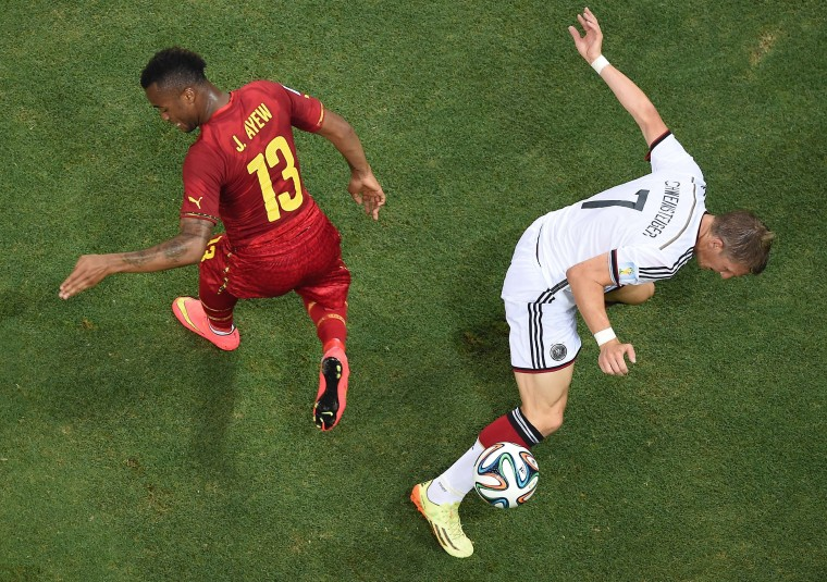 Ghana's forward Jordan Ayew vies with Germany's midfielder Bastian Schweinsteiger during a Group G football match between Germany and Ghana at the Castelao Stadium in Fortaleza during the 2014 FIFA World Cup. (Francois Xavier Marit/Pool/AFP-Getty Images)