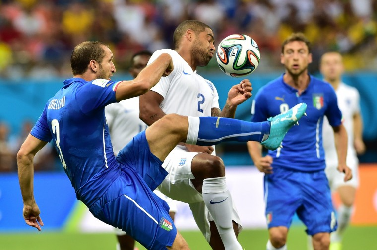 Italy's defenders Giorgio Chiellini (L) and England's defender Mattia De Sciglio vie for the ball during a Group D football match between England and Italy at the Amazonia Arena in Manaus during the 2014 FIFA World Cup. (Giuseppe Cacace/AFP-Getty Images)