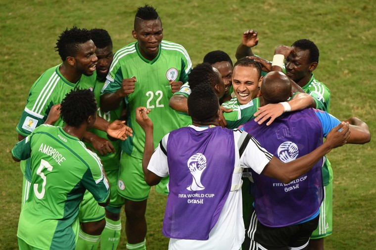 Nigeria's forward Peter Odemwingie (3rd-R) celebrates with teammates after scoring a goal during the Group F football match between Nigeria and Bosnia-Hercegovina at the Pantanal Arena in Cuiaba during the 2014 FIFA World Cup. (Luis Acosta/AFP-Getty Images)