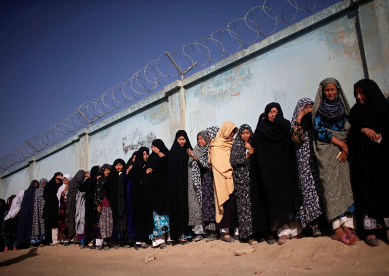 Afghan women wait in line to cast their votes at a polling station in Kabul. Afghans headed back to the polls on Saturday for a second round of voting to elect a successor to President Hamid Karzai. (Ahmad Masood/Reuters)
